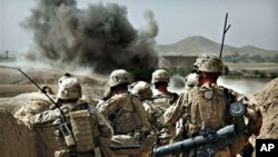 United States Marines from Bravo Company of the 1st Battalion of the 2nd Marines watch the explosion after calling in an air strike during a gunbattle as part of an operation to clear the area of insurgents near Musa Qaleh, in northern Helmand Province, s