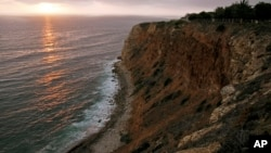 FILE - The sun sets down at the Point Vicente Park on the Pacific Ocean in Palos Verdes, Calif. U.S. Enviromental Protection Agency rank the ocean among the most hazardous places in the country.