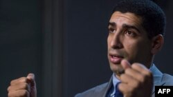 Retired US Army Captain Florent Groberg speaks to reporters at the Pentagon on October 29, 2015 in Washington, DC.