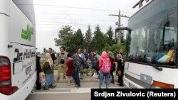 Des bus transportant des migrants