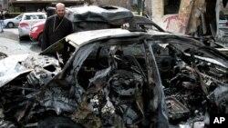 Последствия взрыва у порлицейского участка в районе Баб-Тум, Дамаск. Сирия, 21 октября 2012 года
