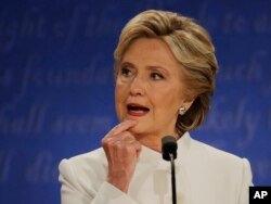 Democratic presidential nominee Hillary Clinton listens to Republican presidential nominee Donald Trump during the third presidential debate at UNLV in Las Vegas, Oct. 19, 2016.