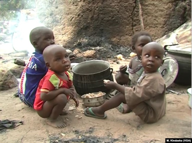 Children eating some food in Tchakarmari village, Cameroon, Apr, 20, 2019.