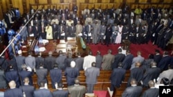 Kenya's politicians gather for the tenth parliament opening, Tuesday, Jan. 15, 2008, Nairobi, the opposition, facing the camera and the government members of parliament with their backs to camera, President Mwai Kibaki is on the left