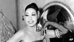 FILE - In this file photo dated March 6, 1961, singer Josephine Baker poses in her dressing room at the Strand Theater in New York City, USA. The remains of American-born singer and dancer Josephine Baker will be reinterred at the Pantheon monument in Paris.
