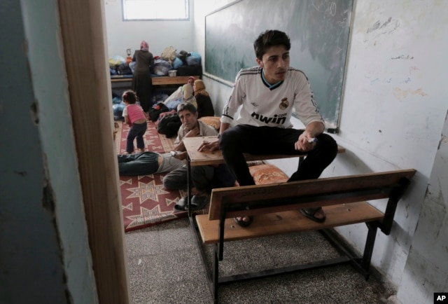 Palestinians take shelter at the United Nations school after they fled their homes in Gaza City, July 13, 2014.
