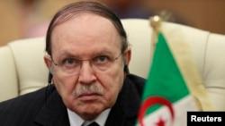 Algeria's President Abdelaziz Bouteflika listens to the speech of Libya's leader Moammar Gadhafi at the third European Union-Africa summit in Tripoli, November 2010.
