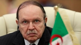 Algeria's President Abdelaziz Bouteflika listens to the speech of Libya's leader Moammar Gadhafi at the third European Union-Africa summit in Tripoli, November 2010.