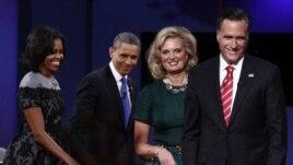 Shugaban Amurka Brack Obama da uwargidansa Michelle, da kuma abokin takararsa Mitt da Ann Romney.