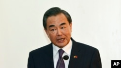 FILE - Chinese Foreign Minister Wang Yi gestures during a press conference.