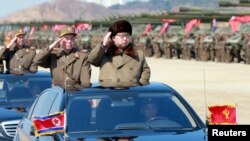 FILE - North Korean leader Kim Jong Un salutes as he arrives to inspect a military drill at an unknown location, in this undated photo released by North Korea's Korean Central News Agency, March 25, 2016.
