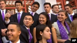 FILE - Members of the Schwarzman Scholars take a selfie as they line up for a group photo before a ceremony to officially open the scholar program at Tsinghua University in Beijing, Saturday, Sept. 10, 2016. (AP Photo/Mark Schiefelbein)