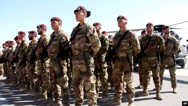 FILE - Italian soldiers with the NATO-led International Security Assistance Force (ISAF) at Camp Arena, Herat Airport, west of Kabul, Afghanistan, Sept, 10, 2013.