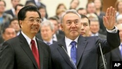 Kazakh President Nursultan Nazarbayev (R) with Chinese President Hu Jintao (L) at a pipeline opening ceremony in Astana, 2009. President Hu Jintao's visit highlighted Beijing's growing influence over Central Asia's strategic energy resources.