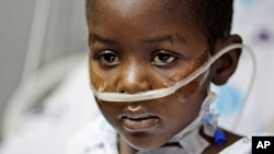 FILE - Five-year-old Haitian boy Woodley Elyse sits on his bed after heart surgery, at the Wolfson Medical center in Holon, near Tel Aviv, Israel, Tuesday, March 2, 2010.