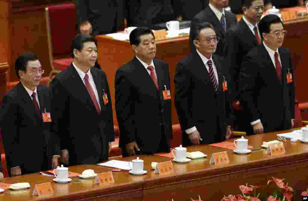 From left, Central Commission for Discipline Inspection head He Guoqiang, Chinese Vice President Xi Jinping, People's Political Consultative Conference Chairman Jia Qinglin, National People's Congress Chairman Wu Bangguo and Chinese President Hu Jintao at the Communist Party Congress, November 14, 2012.
