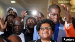 Zimbabwe's former vice president Joice Mujuru smiles while addressing supporters in Harare, March 1, 2016.