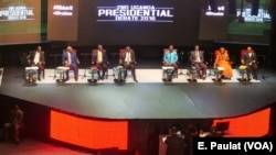 Presidential candidates take turn answering a series of questions on foreign policy and internal security during the debate in Kampala, Uganda, Feb. 13, 2016.