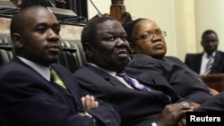 Zimbabwe Vice President Joice Mujuru (R), Prime Minister Morgan Tsvangirai (C) and member of the House of Assembly of Zimbabwe for Kuwadzana, Nelson Chamisa, attend the presentation of the Final Draft of the Constitution for debate in Parliament Building.