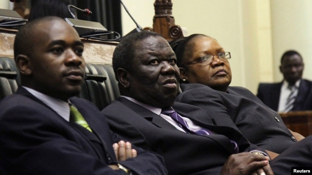 Zimbabwe Vice President Joice Mujuru (R), Prime Minister Morgan Tsvangirai (C) and member of the House of Assembly of Zimbabwe for Kuwadzana, Nelson Chamisa, attend the presentation of the Final Draft of the Constitution for debate in Parliament Building