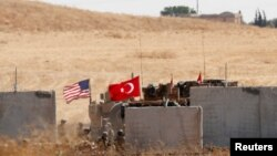 Pasukan Turki dan AS dari patroli gabungan AS-Turki di Suriah utara, tiba di Akcakale, Turki, 8 September 2019.