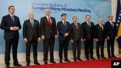From left, Prime Ministers Aleksandar Vucic (Serbia), Dusko Markovic (Montenegro), Edi Rama (Albania), Denis Zvizdic (Bosnia), EU Commissioner for Enlargement Johannes Hahn, Emil Dimitriev (Macedonia), Isa Mustafa (Kosovo) and Italian Foreign Minister Angelino Alfano poses for photo during a summit of Western Balkan leaders in Sarajevo, Bosnia, March 16, 2017.