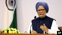 FILE - Indian Prime Minster Manmohan Singh addresses a press conference, in New Delhi, India.