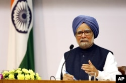 FILE - former Indian Prime Minster Manmohan Singh addresses a press conference.