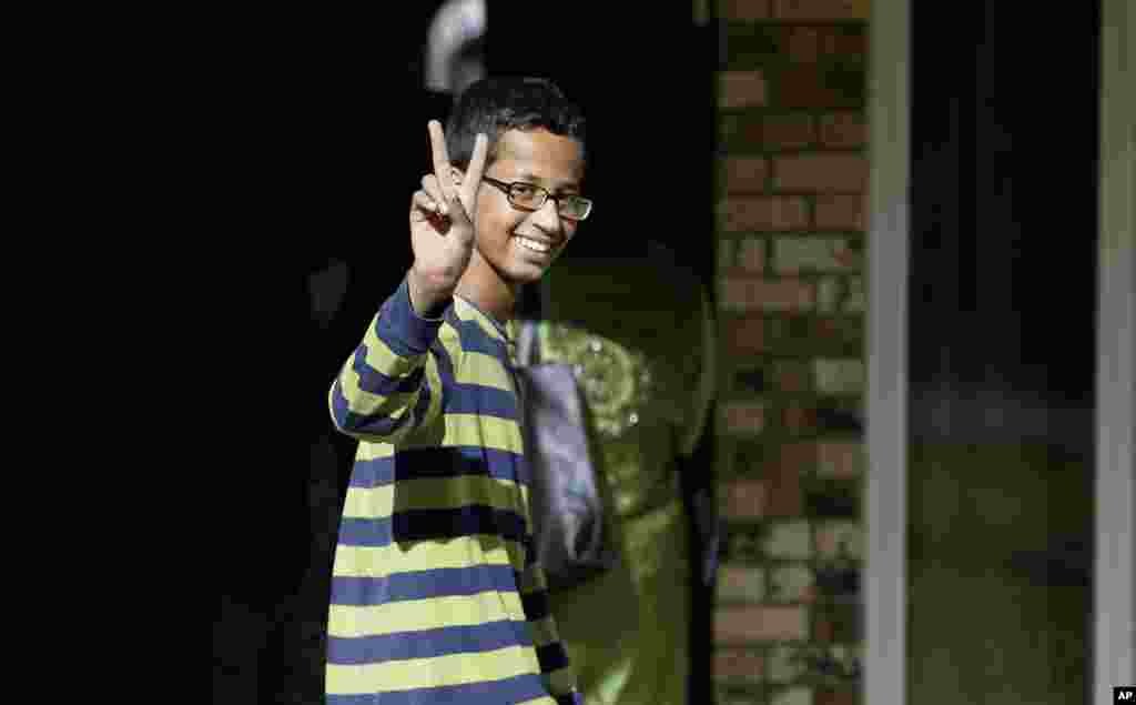 Ahmed Mohamed, 14, gestures as he arrives at his family's home in Irving, Texas, USA. Ahmed was arrested at his school on Sept. 16 after a teacher thought a homemade clock he built was a bomb. He remains suspended and said he will not return to classes at MacArthur High School. President Barack Obama invited Mohamed to bring his clock to the White House.
