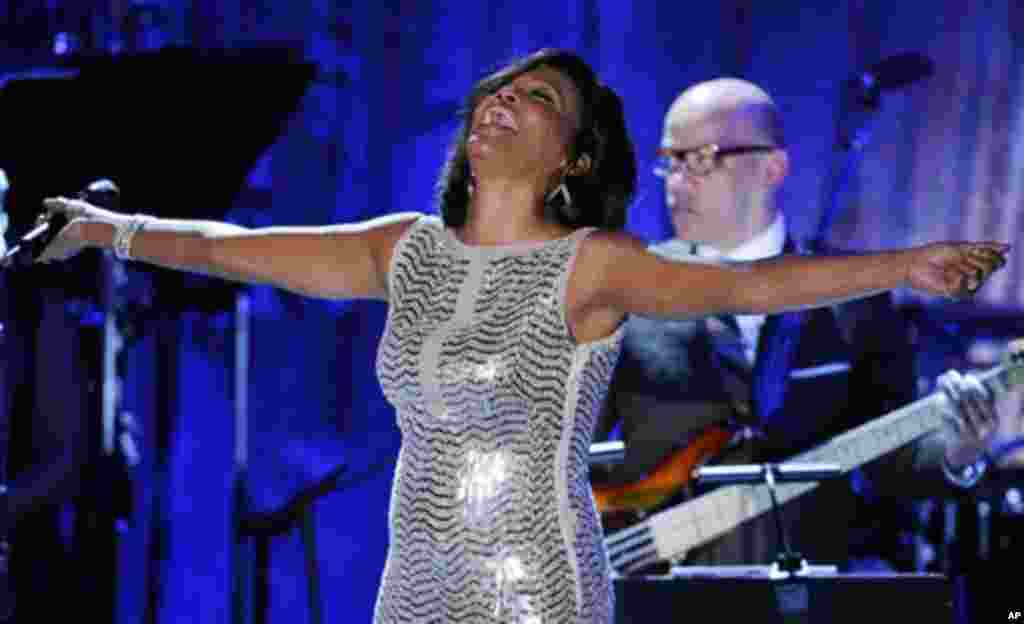 Singer Whitney Houston performs at the pre-Grammy gala & salute to industry icons with Clive Davis honoring David Geffen, Sunday, Feb. 13, 2011, in Beverly Hills, Calif. (AP Photo/Mark J. Terrill)