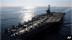 Nimitz-class aircraft carrier USS John C. Stennis transits the Strait of Hormuz, Nov. 12, 2011 (file photo).