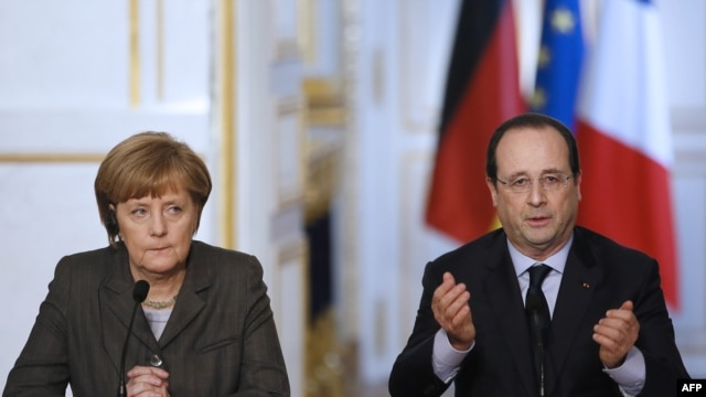 German Chancellor Angela Merkel (L) and French president François Hollande give a press conference on Feb. 19, 2014 at the Elysee Palace in Paris.