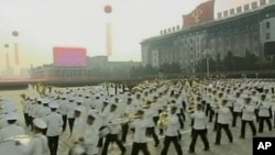 In this image made from KRT footage distributed by APTN, participants perform during a huge military parade marking the 65th anniversary of the founding of North Korea's Workers' Party, Sunday, Oct. 10, 2010, in Pyongyang.