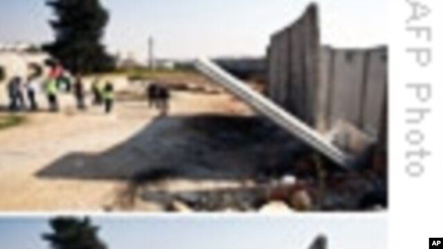W. Bank Palestinians Tear Down Segment of Barrier Wall