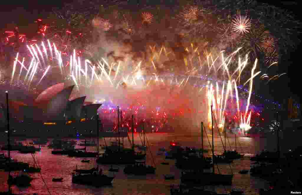 Fireworks light up the Sydney Harbour Bridge and Sydney Opera House during new year celebrations on Sydney Harbour, Australia, Jan. 1, 2018.
