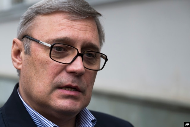 FILE - Opposition leader and former Russian Prime Minister Mikhail Kasyanov speaks to the media in Moscow, Feb . 28, 2015.