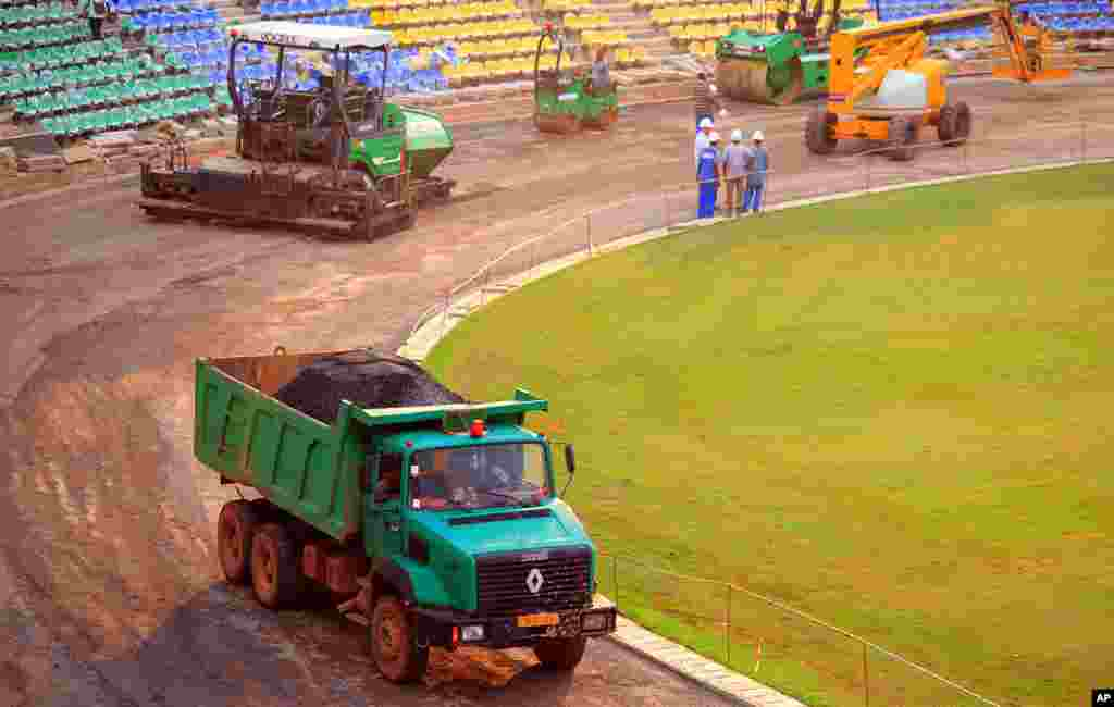 Trucks and heavy equipment at the site of the Franceville stadium under construction (Gabon Local Organizing Committee)