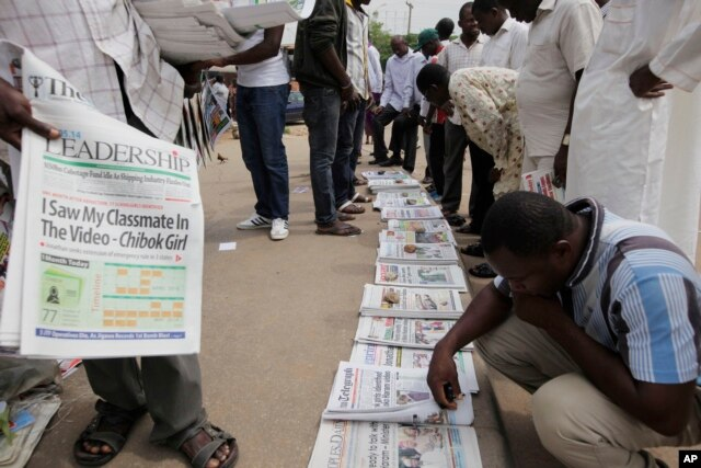 "People read local newspapers with headlines stating, ""I saw my classmate in the video,"" referring to the kidnapped girls of the Chibok school shown in a video released May 12 by Boko Haram in Abuja, Nigeria, May 14, 2014."