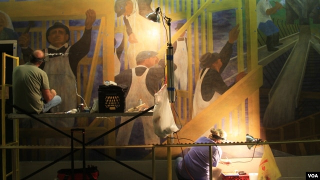 Conservators at work in July 2012 on the West Wall of The Meaning of Social Security
