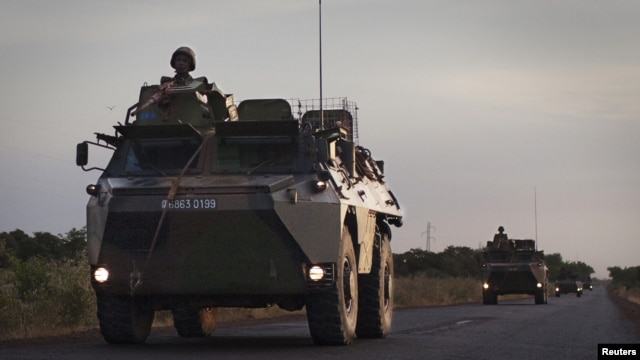 A convoy of French military vehicles drive on a road outside Markala, January 22, 2013.