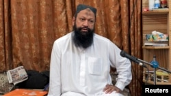 FILE - Leader of the Lashkar-e-Jhangvi (LeJ) Malik Ishaq speaks during an interview with Reuters at his home in Rahim Yar Khan in southern Punjab province October 9, 2012.