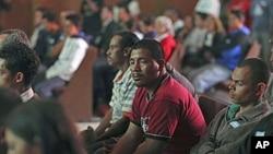 Migrantes centroamericanos durante una misa en México.