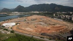 FILE - Olympic Park, that will host competitions for 10 sports at Rio's Olympics in 2016, is under construction in the area previously occupied by the Jacarepagua Autodrome in Rio de Janeiro, Brazil.