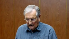 In this Nov. 9, 2013 released by the Korean Central News Agency, U.S. citizen Merrill Newman, 85, reads a document, which North Korean authorities say was an apology that Newman wrote and read in North Korea.