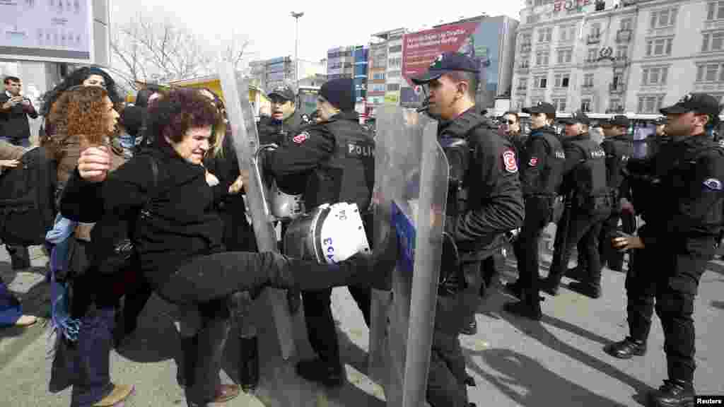 Demonstrators are stopped by the police during a protest ahead of the International Women's Day, in Istanbul, Turkey, March 6, 2016.