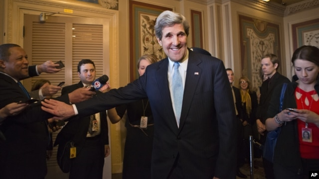 Sen. John Kerry, D-Mass., emerges after a unanimous vote by the Senate Foreign Relations Committee approving him to become America's next top diplomat, replacing Secretary of State Hillary Rodham Clinton, on Capitol Hill in Washington, January 29, 2013.