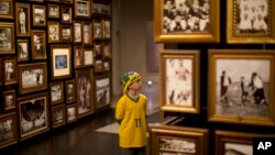 In this June 12, 2014 photo, a young Brazil soccer fan visits the Hall of Origins at the Soccer Museum in Sao Paulo, Brazil.