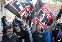 FILE - Forza Nuova extreme right-wing party activists shout slogans during a demonstration in Milan, Italy, May 22 , 2010.