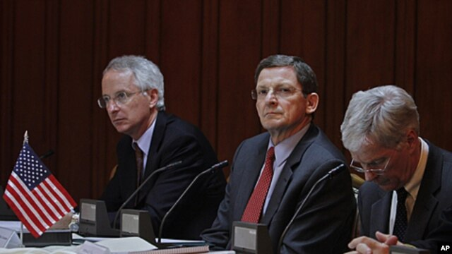 U.S. special envoy for Afghanistan and Pakistan Marc Grossman (C), U.S. Ambassador to Pakistan Cameron Munter (L), and U.S. Ambassador to Afghanistan Ryan Crocker attend a tripartite meeting of Pakistani, U.S. and Afghan officials at the foreign ministry
