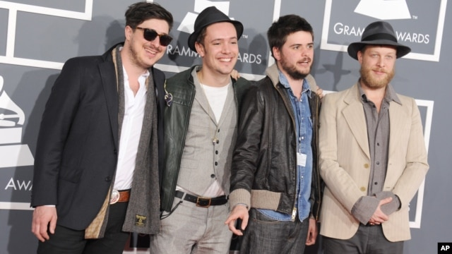 From left, Marcus Mumford, Ben Lovett, Country Winston and Ted Dwane, of musical group Mumford & Sons, arrive at the 55th annual Grammy Awards in Los Angeles, Feb. 10, 2013.